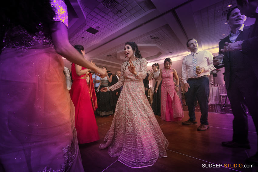 Indian Wedding Photography Awesome dancing at Eagle Crest Marriott SudeepStudio.com Ann Arbor South Asian Indian Wedding Photographer