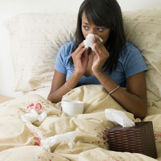 Young adult sick in bed