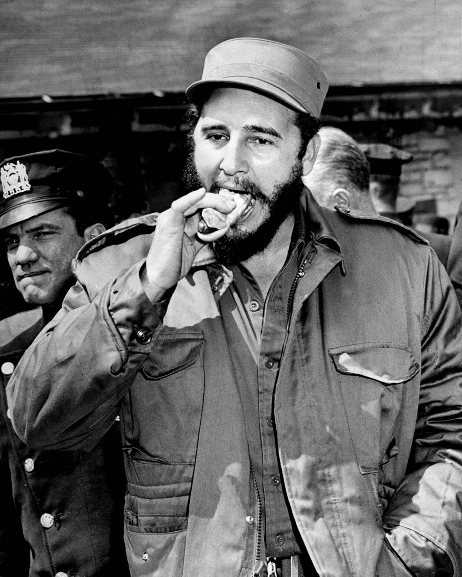 Castro takes a bite out of a hot dog at the Bronx Zoo.