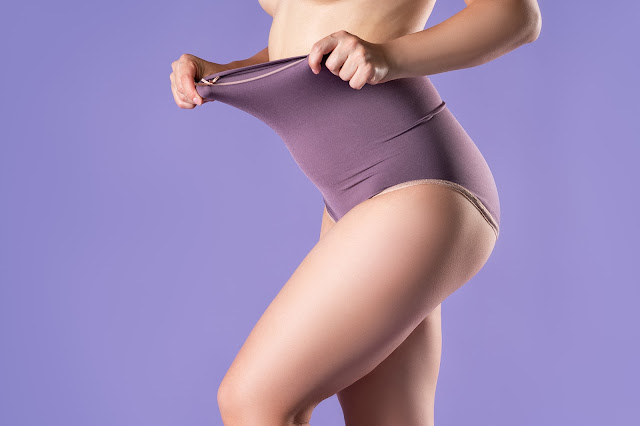 https://www.istockphoto.com/photo/woman-in-high-waisted-corrective-panties-female-body-in-shapewear-on-purple-gm1276958305-376303384