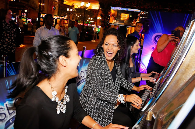 Kriya Gangiah, Stacey Holland and Rikki Brest have fun at the Slots machines