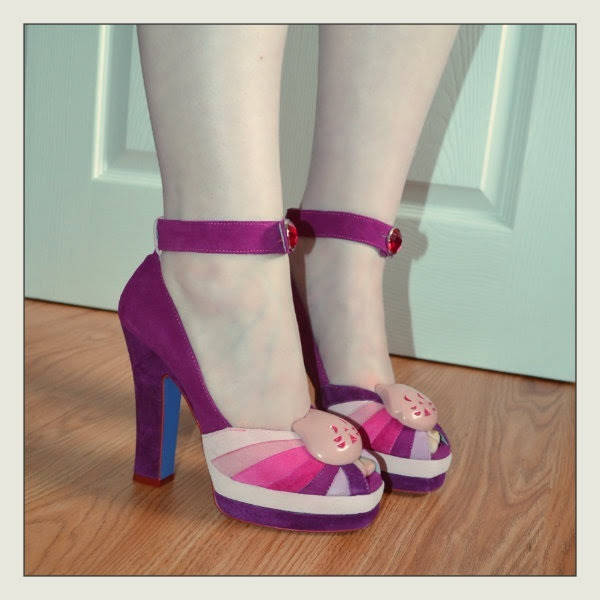 side view of Irregular Choice Kitty Princess shoes on feet in purple and pink suede with jewel on ankle strap