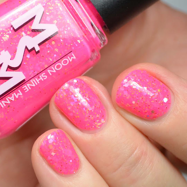 hot pink nail polish with flakies swatch