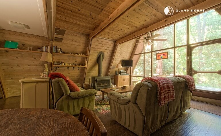 03-Living-Room-Glamping-Hub-A-Frame-House-Architecture-www-designstack-co