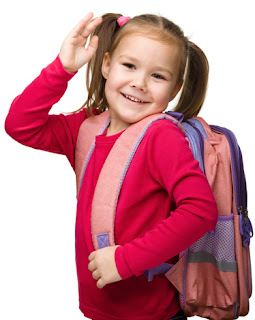 Photo of a happy little girl wearing a backpack for back to school