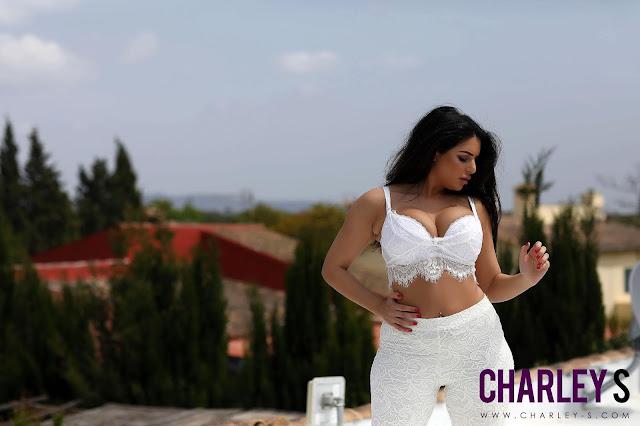 Charlotte Springer striptease on roof