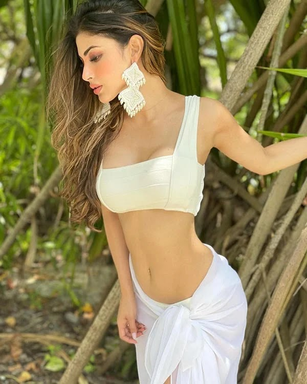 Mouni Roy's sexy slim waist in this white outfit is raising the temperature.