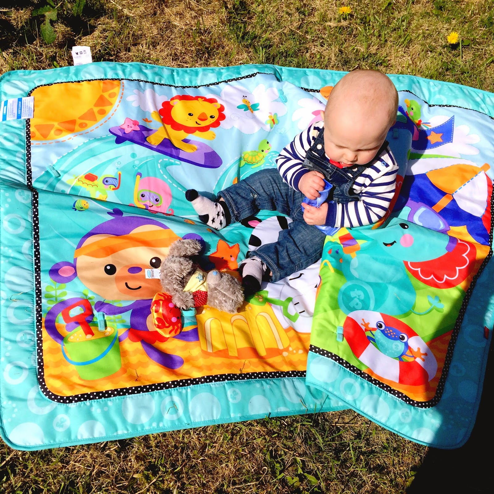 Jacob in the garden on his playmat in the sunshine
