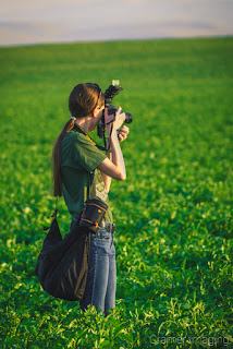 Cramer Imaging's behind-the-scenes photo of Audrey with a camera in a potato field in Idaho