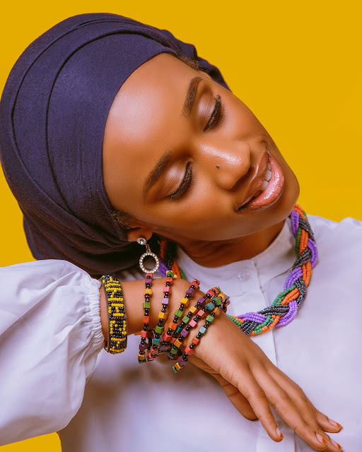 African woman wearing colorful beaded necklaces.