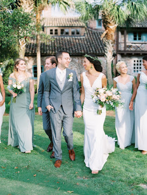 bride, groom and bridal party walking