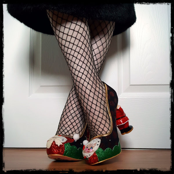 crossed legs wearing gold fishnet tights and irregular choice christmas shoes