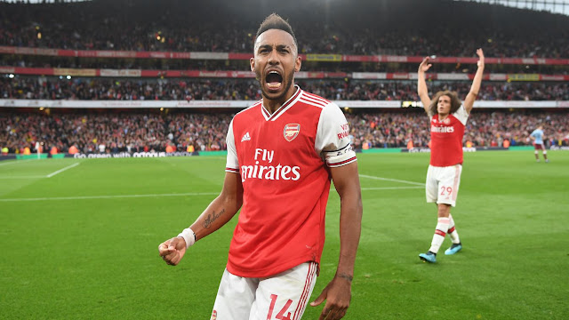 Arsenal 3-2 Aston Villa Arsenal's Pierre-Emerick Aubameyang celebrates after scoring the goal that settled this five-goal thriller
