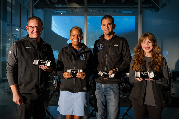The Inspiration4 crewmembers pose with the astronaut wings that they received during a surprise ceremony at SpaceX Headquarters in Hawthorne, California...on October 1, 2021.