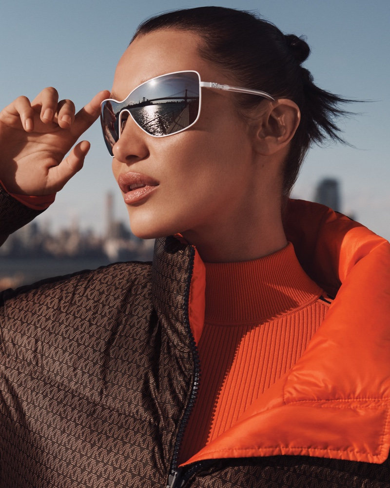 Bella Hadid wears sunglasses in MICHAEL Michael Kors fall-winter 2021 campaign.