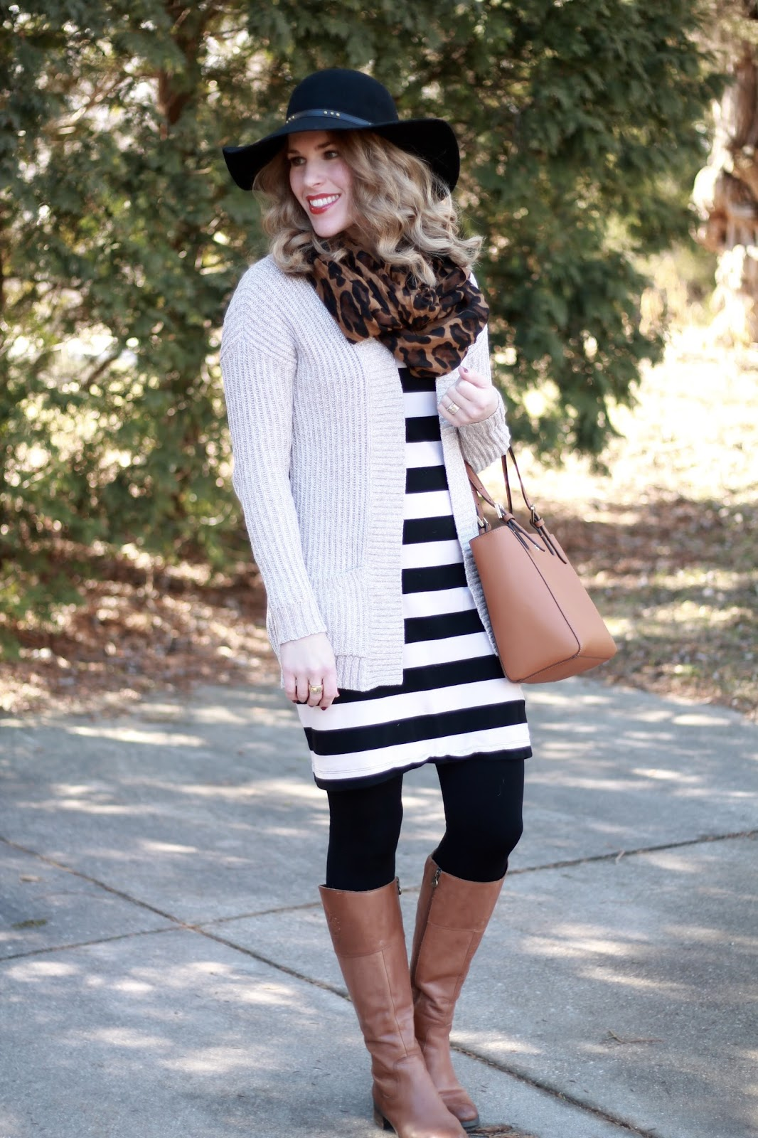 black and white striped dress, beige cardigan, black floppy hat, cognac riding boots, leopard scarf, Tory Burch  tote