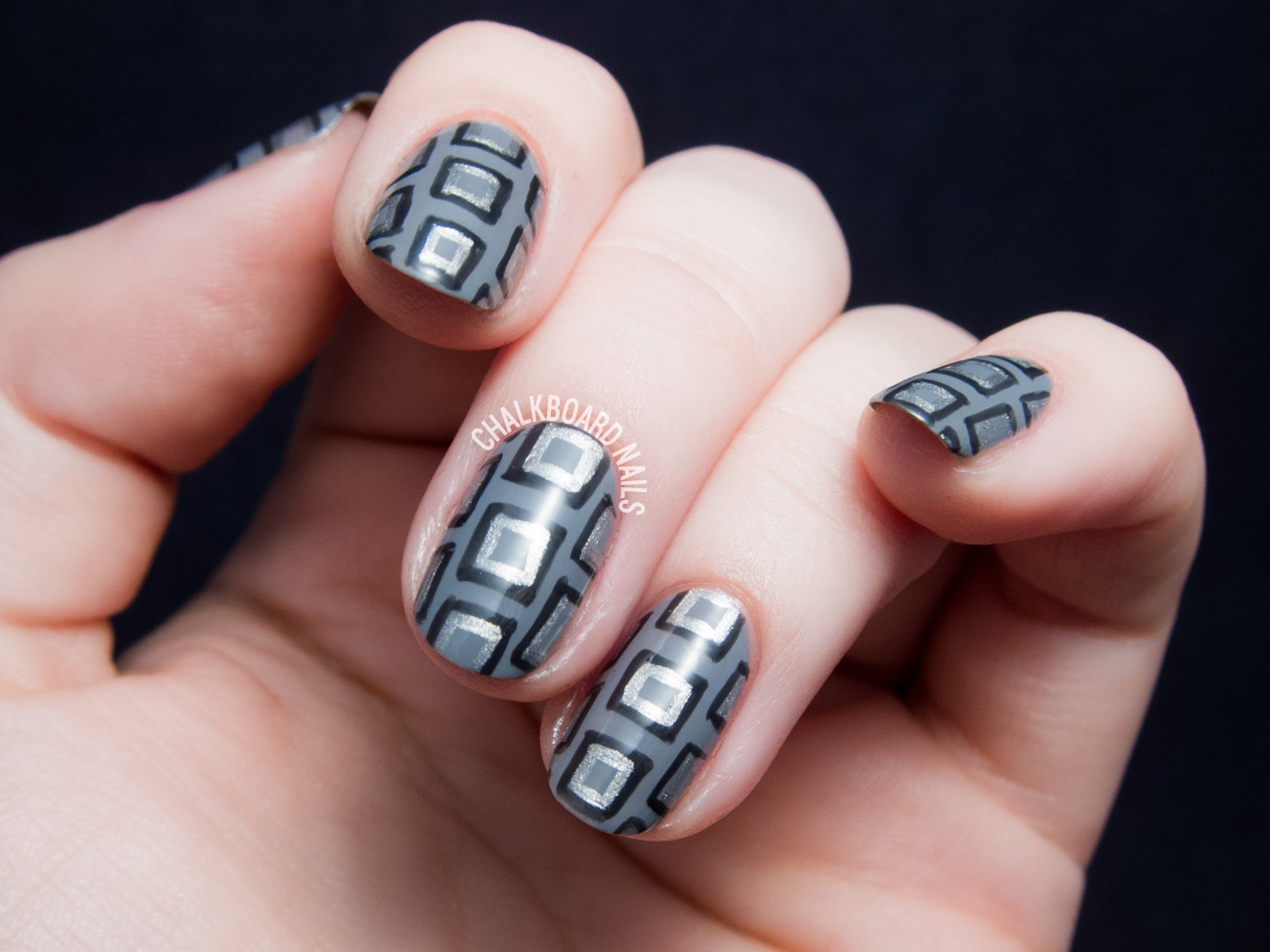 Monochrome geometric nail art by @chalkboardnails