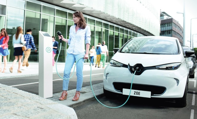 woman about to start charging a Renault Zoe EV