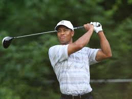 Woods perseveres through horrible begin to British Open