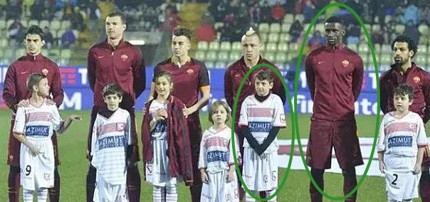 italian boy refuses stand black player monkey