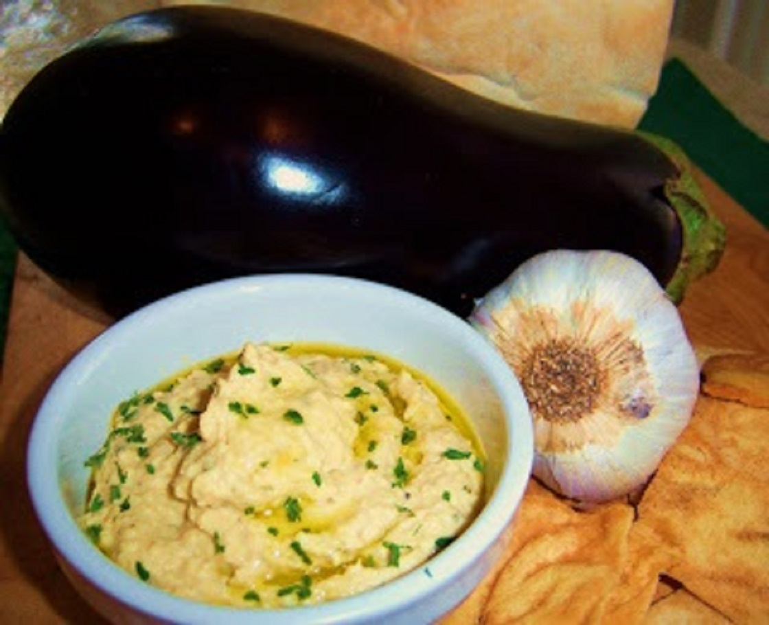 a bowl of Eggplant Hummus with Roasted Garlic