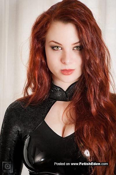 Redhead with green eyes wears black latex top