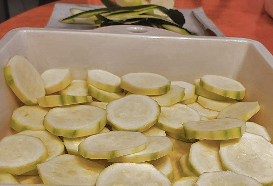 this is sliced zucchini in a casserole dish