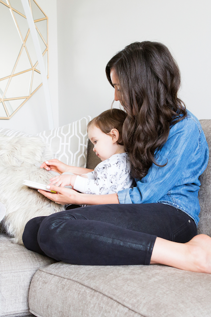 Mom Baby Reading Board Book Together on Couch