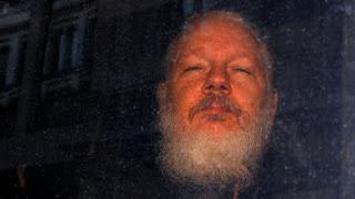 julian-assange-tortured
