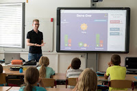 A Teachers teaches students with gaming, learning process