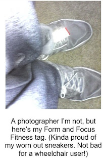 Pair of sneakers with ID tag on left shoe. Caption reads: A photographer I'm not, but here's my Form and Focus Fitness tag. (Kinda proud of my worn out sneakers. Not bad for a wheelchair user!)