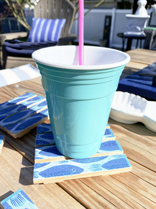 teal drink cup on fish drink coaster