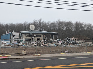 On Sunday's walk, the auto dealer building is half gone