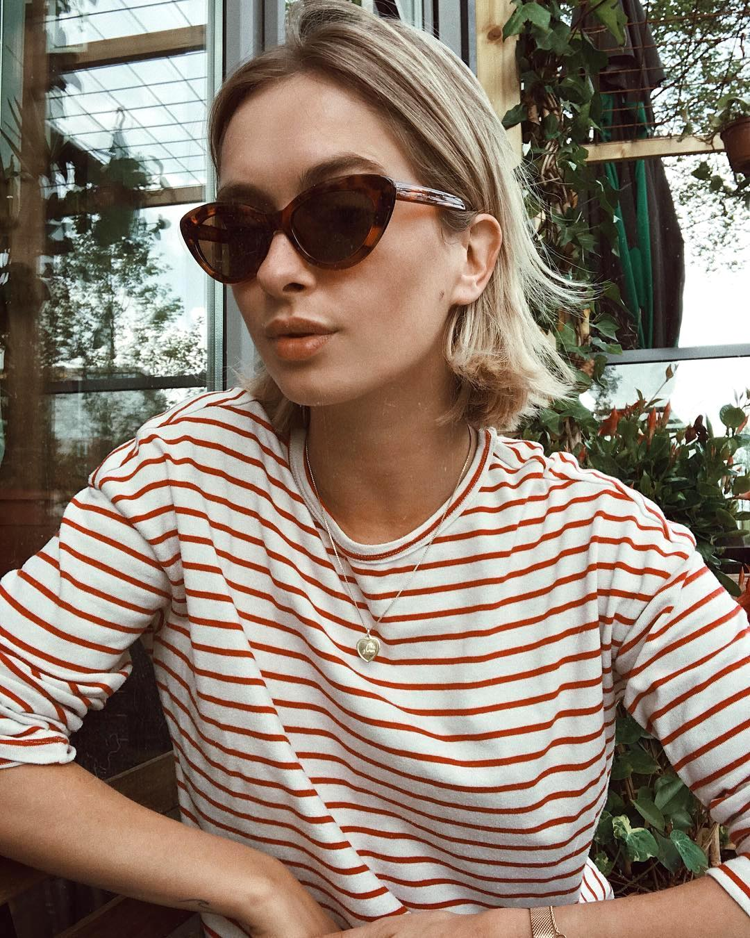 25 Cool Striped Long-Sleeve T-Shirts to Shop Now — Rianne Meijer In Cat-Eye Sunglasses and a Red Striped Tee