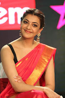 Kajal Aggarwal in Red Saree Sleeveless Black Blouse Choli at Santosham awards 2017 curtain raiser press meet 02.08.2017 075.JPG