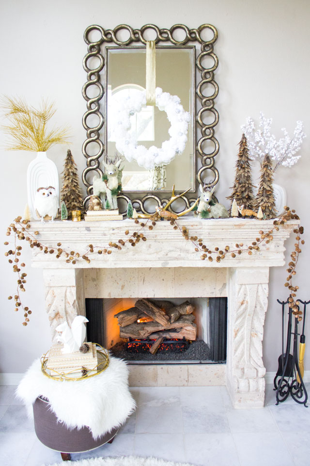 Love this beautiful winter woodland themed mantel!
