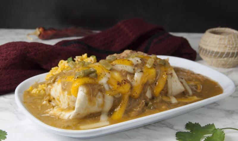 Denver Green Chili Topped Breakfast Burrito with Processed Cheese and Minced Chili Topping