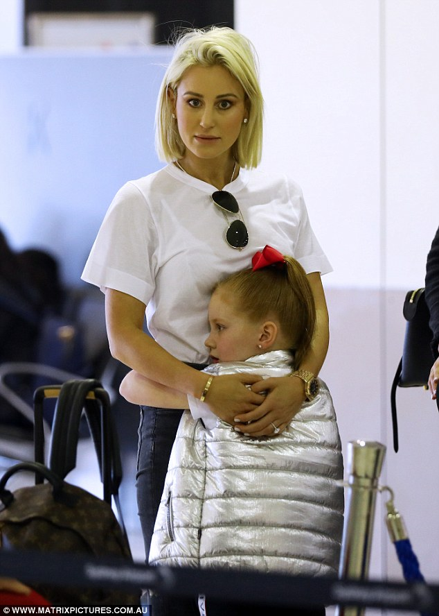 Roxy Jacenko and Oliver Curtis pack on the PDA as they jet to Europe with their children