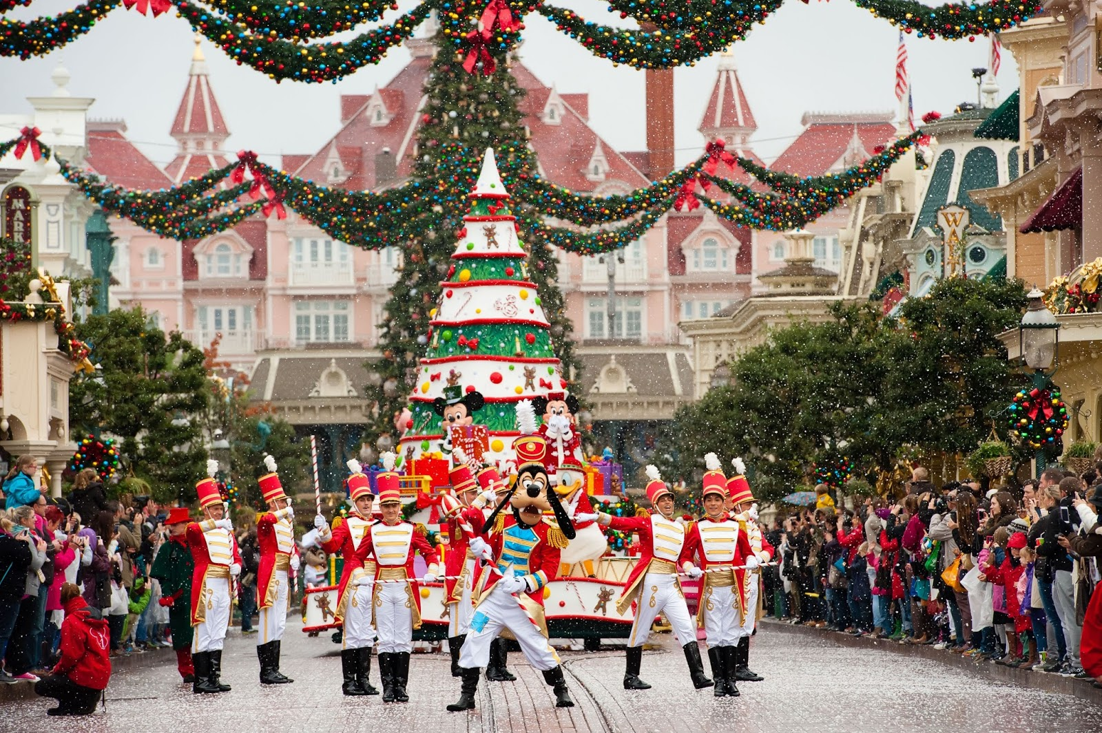 along with mickey and minnie father christmas ensures that the huge 78 foot christmas tree illuminates in the town square every day to the sound of
