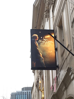 photo of hanging sign advertising Ian McKellen's show and including photo of him