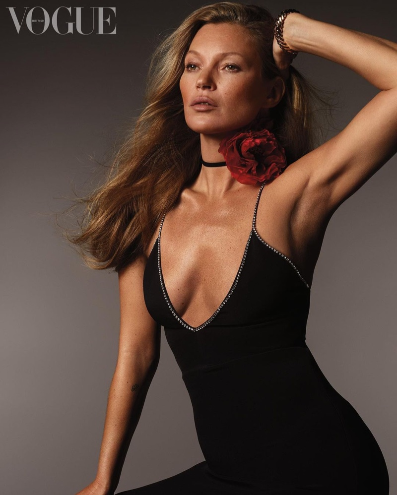 Kate Moss poses in Celine dress with Carter watch and Petershams corsage.