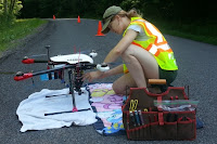 Charlotte Levy examines a drone that will examine albedo before flight. (Credit: cornell.edu) Click to Enlarge.