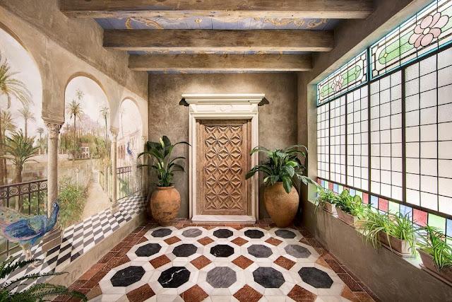 Hallway to garden by Ignacio Carrillo