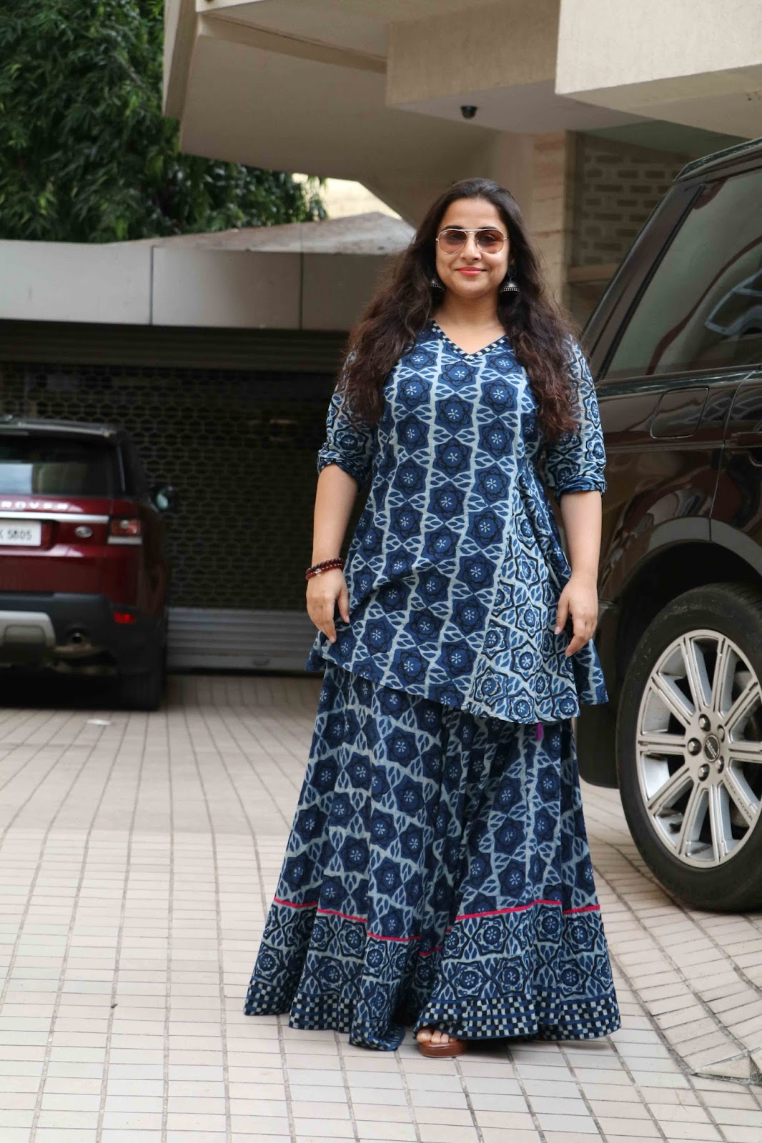 Beautiful Hindi Actress Vidya Balan Long Hair Photos  With glass In Blue Dress