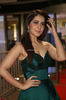 Raashi Khanna in Dark Green Sleeveless Strapless Deep neck Gown at 64th Jio Filmfare Awards South ~  Exclusive 105.JPG