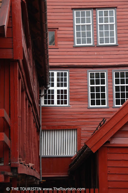 Facade of a red wooden house in UNESCO listed Bryggen in Bergen in Norway.
