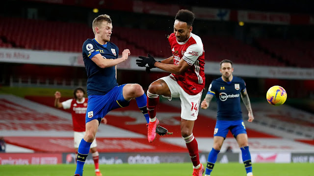 Southampton midfielder James Ward-Prowse and Aubameyang battles for the ball