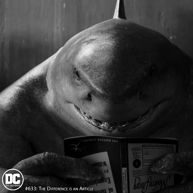 King Shark reading (The Suicide Squad). Text: DC on SCREEN Podcast 633