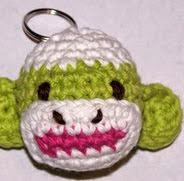 http://www.ravelry.com/patterns/library/free-sock-monkey-head-key-chain