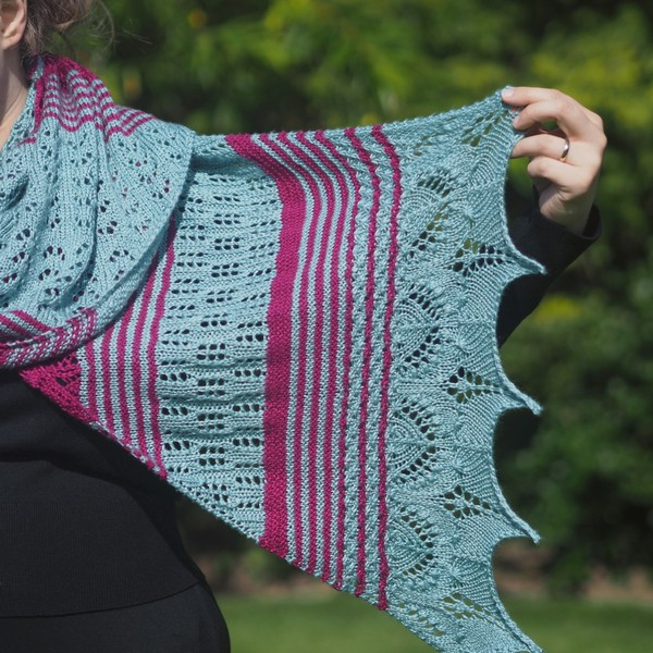 Edge of seafoam and magenta lace wrap being held up